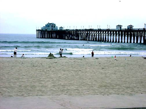 Oceanside California pier beach, a short walk south from our vacation rental condos, click to enlarge